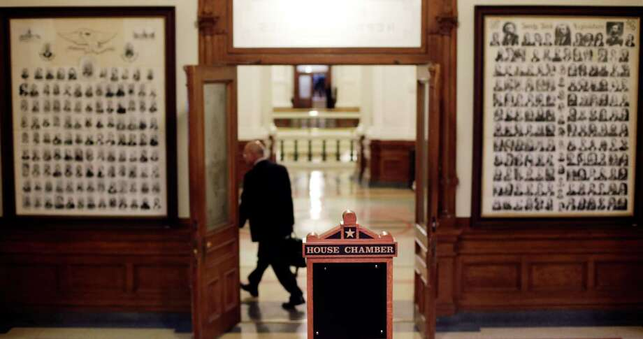 A lawmaker leaves the Texas House of Representatives after members passed a final transportation funding bill and adjourned Monday in Austin. Photo: Eric Gay, STF / AP