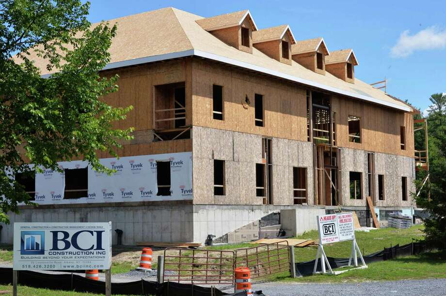 Construction continues on Loudon House condo project in Colonie, NY, Tuesday July 30, 2013.  (John Carl D'Annibale / Times Union) Photo: John Carl D'Annibale