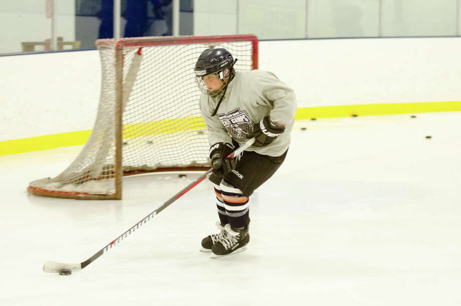 Christian Nawrocki, 10, of Darien, runs a drill during hockey camp coached by NHL Hockey player Matt Moulson of the NY Islanders at the Stamford Twin Rinks in Stamford on Tuesday, Aug. 6, 2013. Photo: Amy Mortensen / Connecticut Post Freelance