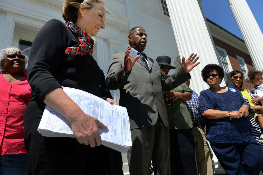 Democratic Mayoral candidate Joe Paul speaks to the media as his supporters stand by his side before delivering the required petitions to run for mayor at Stratford Town Hall in Stratford, Conn. on Tuesday August 6, 2013. Holding the petitions is Paul's Campaign Manager Terry Masters. Photo: Christian Abraham / Connecticut Post