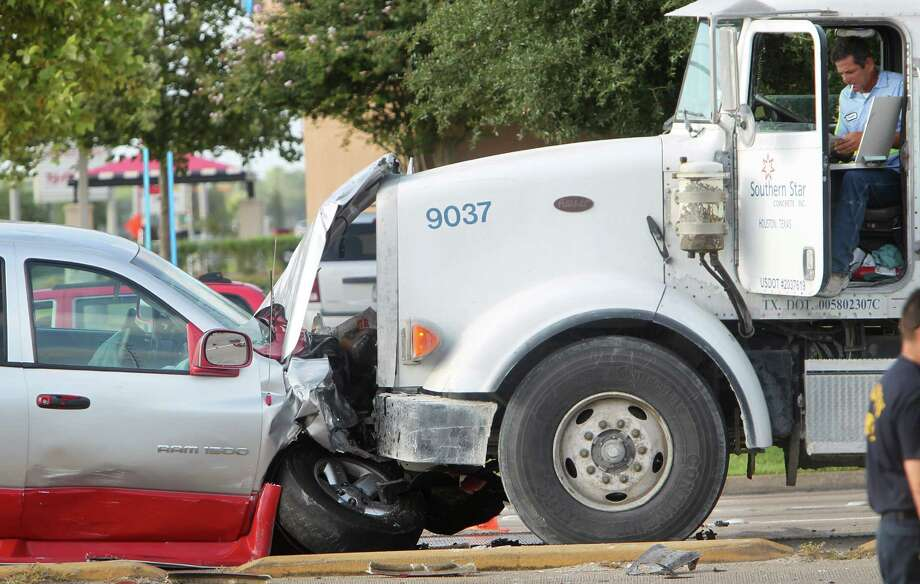 The driver of this pickup was taken to Hermann Southwest Hospital on Tuesday after hitting a cement truck head-on at Westheimer and Eldridge Parkway while fleeing from police. The driver of a third vehicle died. Photo: Mayra Beltran, Staff / © 2013 Houston Chronicle