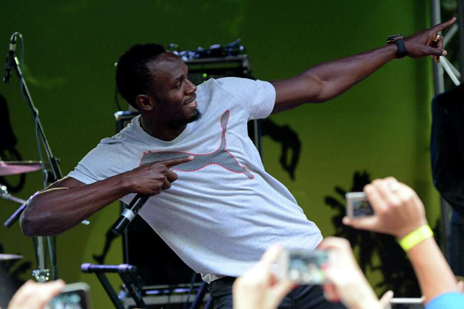 Jamaica's sprinter Usain Bolt attends a party in central Moscow on August 4, 2013 ahead of the world athletics championships which will take place in Moscow on August 10-18. AFP PHOTO/KIRILL KUDRYAVTSEVKIRILL KUDRYAVTSEV/AFP/Getty Images Photo: KIRILL KUDRYAVTSEV / AFP