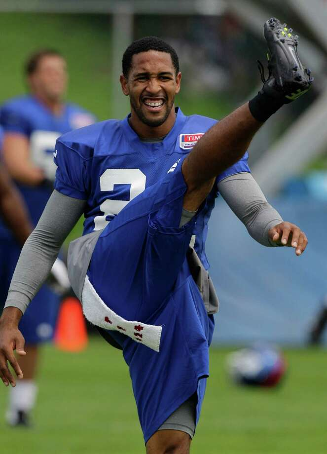 FILE - In this July 29, 2012, file photo, New York Giants cornerback Terrell Thomas does a high kick while warming up before a workout at NFL football training camp in Albany, N.Y. Thomas practiced Tuesday, Aug. 6, 2013, for the first time since training camp opened. He started camp on the active PUP list. (AP Photo/Kathy Willens, File) ORG XMIT: NY168 Photo: Kathy Willens / AP