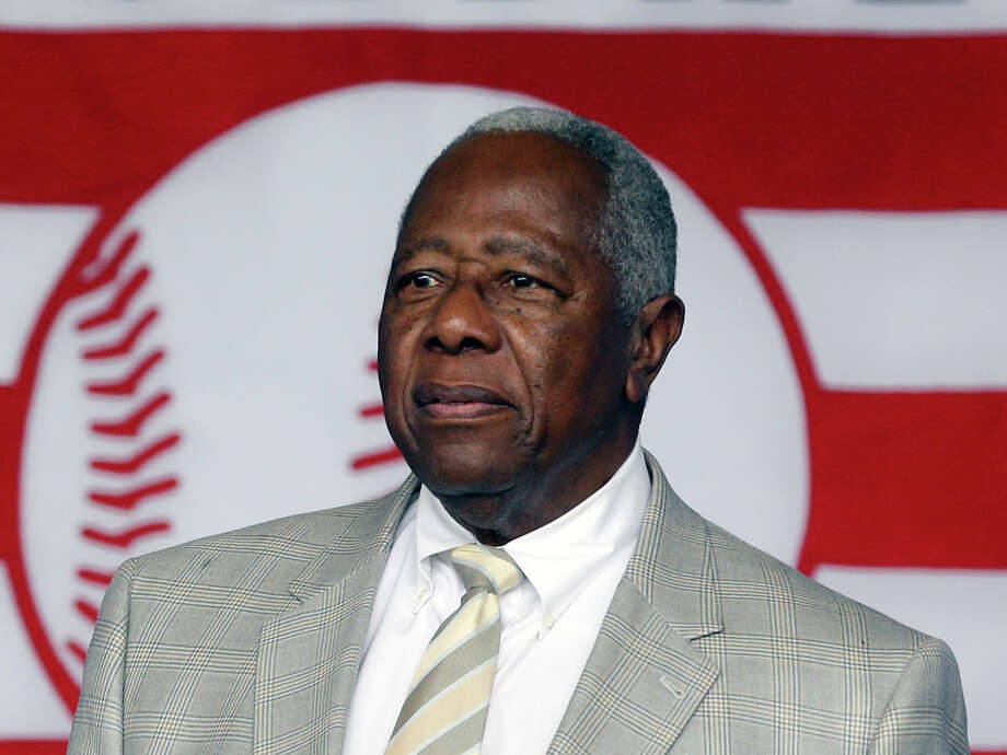 FILE - In this July 28, 2013 file photo, Hall of Famer Hank Aaron walks on stage during the Baseball Hall of Fame induction ceremony in Cooperstown, N.Y. Atlanta police say they've made an arrest in a burglary at Aaron's home. Police Sgt. Greg Lyon said one suspect was in custody Monday night, Aug. 5, 2013. (AP Photo/Mike Groll, File) ORG XMIT: NY150 Photo: Mike Groll / AP