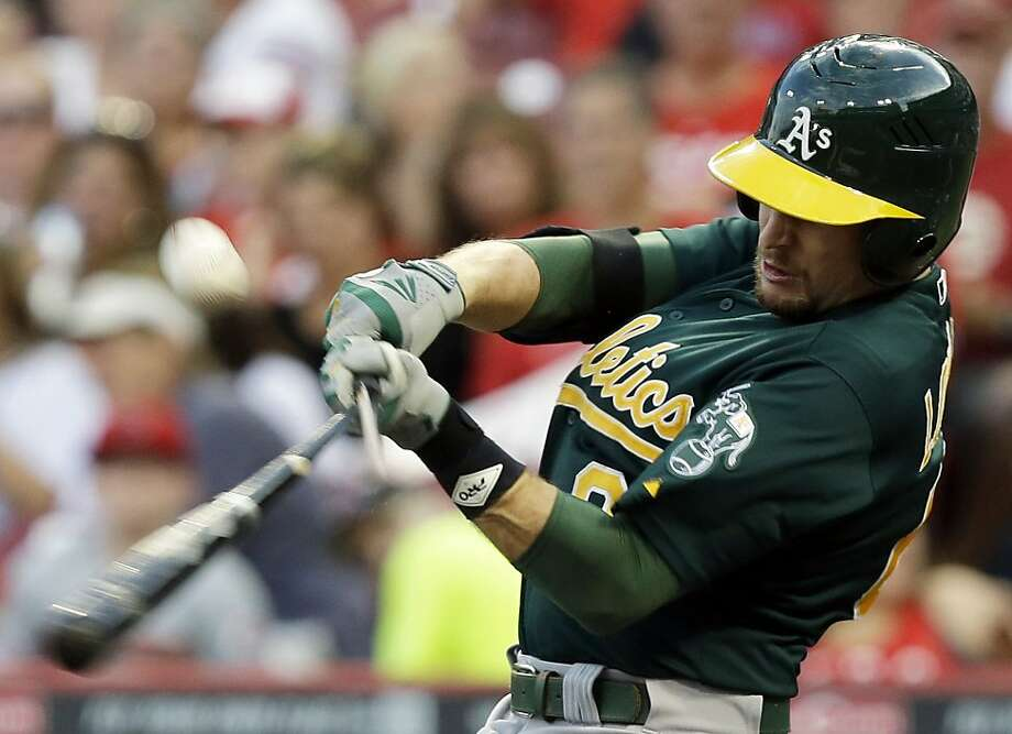 Jed Lowrie, who at least had a hit, breaks his bat on a third-inning popup. Photo: Al Behrman, Associated Press