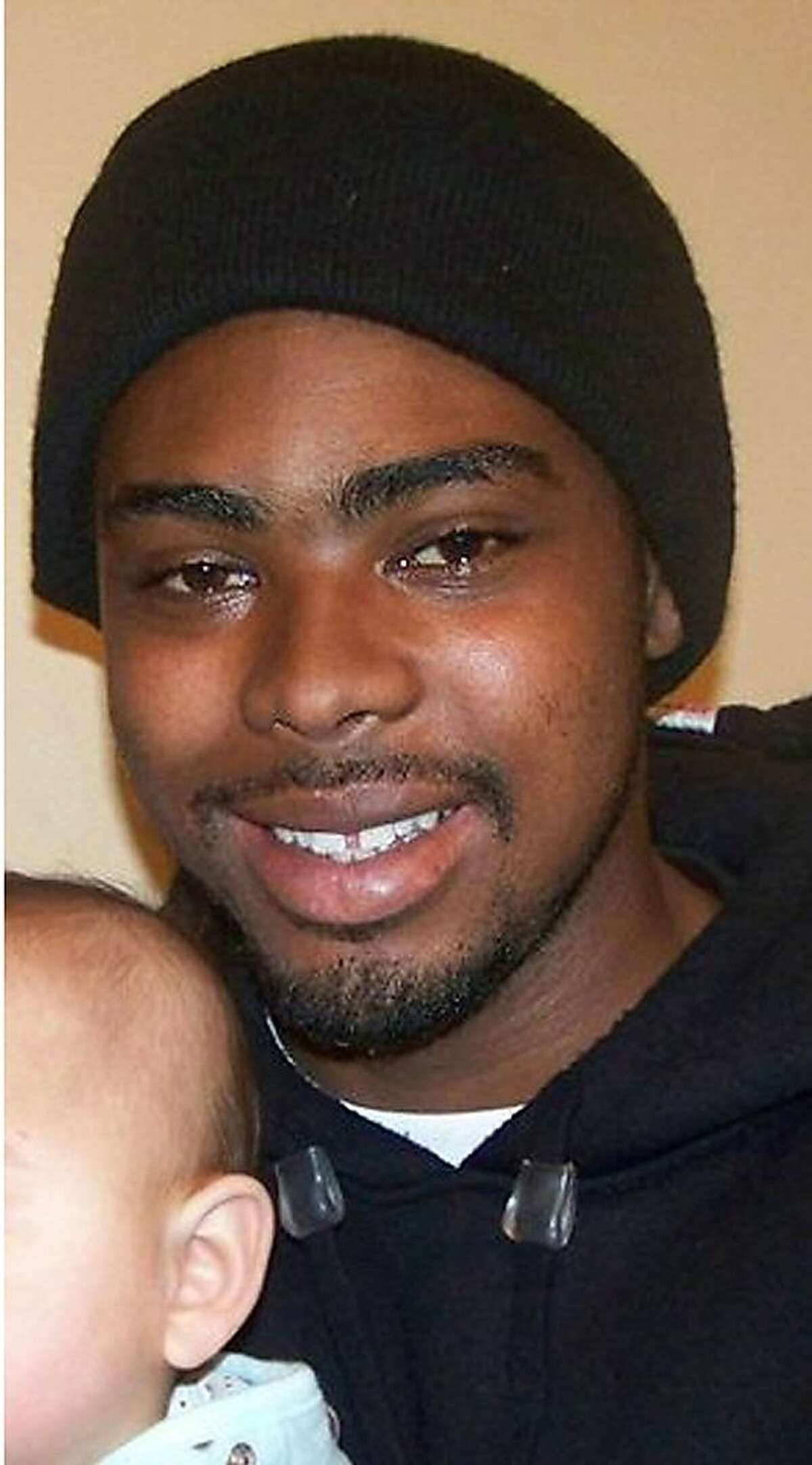 FILE - This undated family photo provided by the Law Offices of John Burris shows Oscar Grant, a 22-year-old transit rider who was shot and killed by Bay Area Rapid Transit police on New Year's Day 2009.