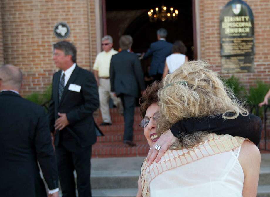Mourners file into Trinity Episcopal Church to attend a private memorial service for George Mitchell Tuesday, Aug. 6, 2013, in Galveston. Photo: Johnny Hanson, Houston Chronicle / © 2013  Houston Chronicle