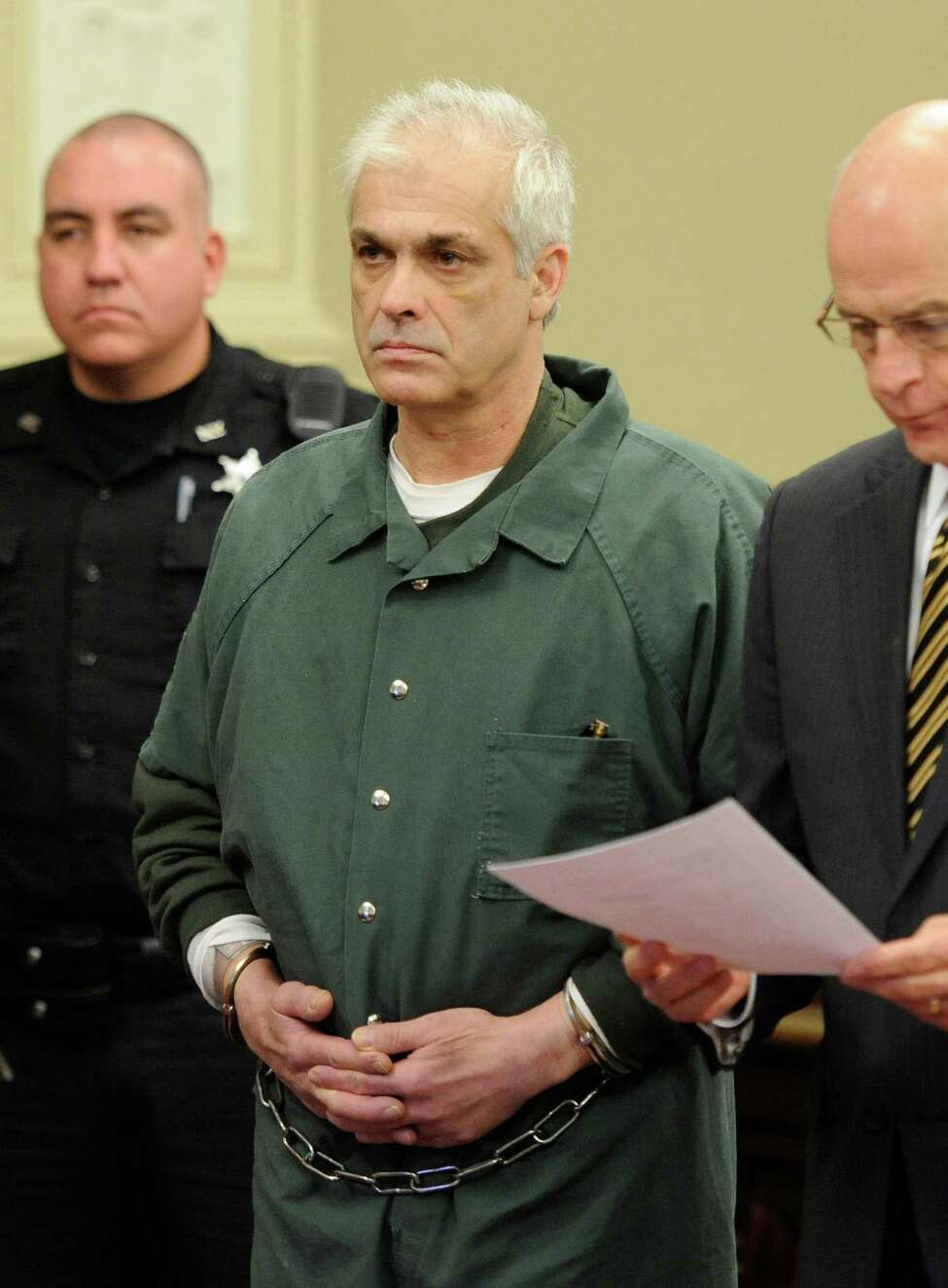 Rory Poulin, center, is arraigned on murder charges at the Rensselaer County Courthouse in Troy, N.Y. Dec. 15, 2011. (Skip Dickstein / Times Union archive)
