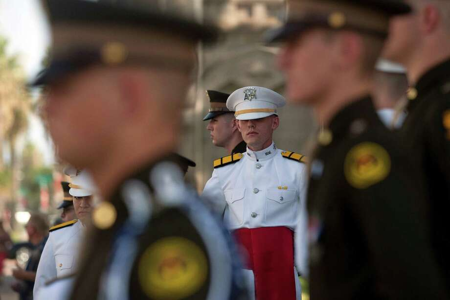 Texas A&M Ross Volunteer Company stand guard outside of Trinity Episcopal Church during a private memorial service for George Mitchell Tuesday, Aug. 6, 2013, in Galveston. Photo: Johnny Hanson, Houston Chronicle / © 2013  Houston Chronicle
