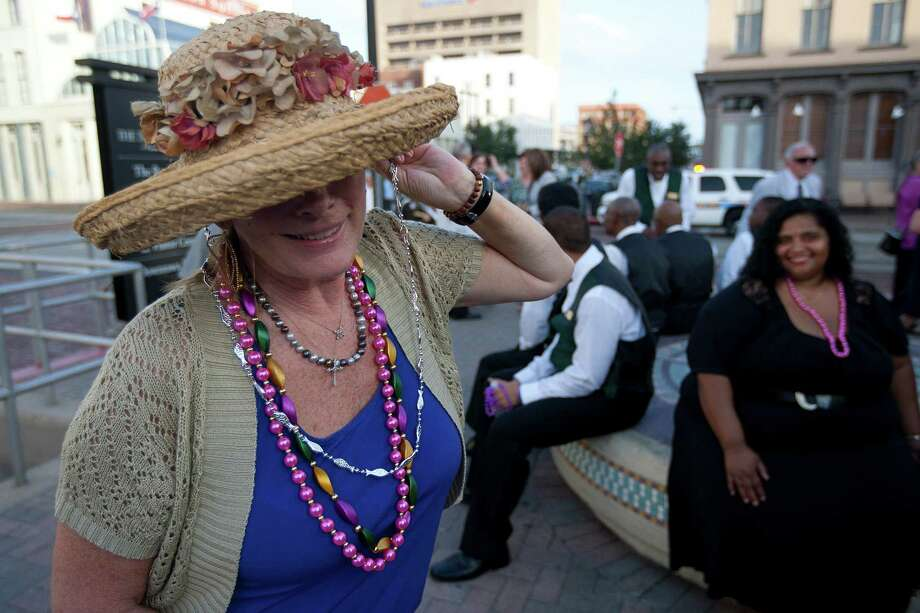 """He was Mr. Galveston,"" friend Pam Blanton said as she put on Mardi Gras beads during a public memorial service for George Mitchell at Saengerfest Park Tuesday, Aug. 6, 2013, in Galveston. Photo: Johnny Hanson, Houston Chronicle / © 2013  Houston Chronicle"