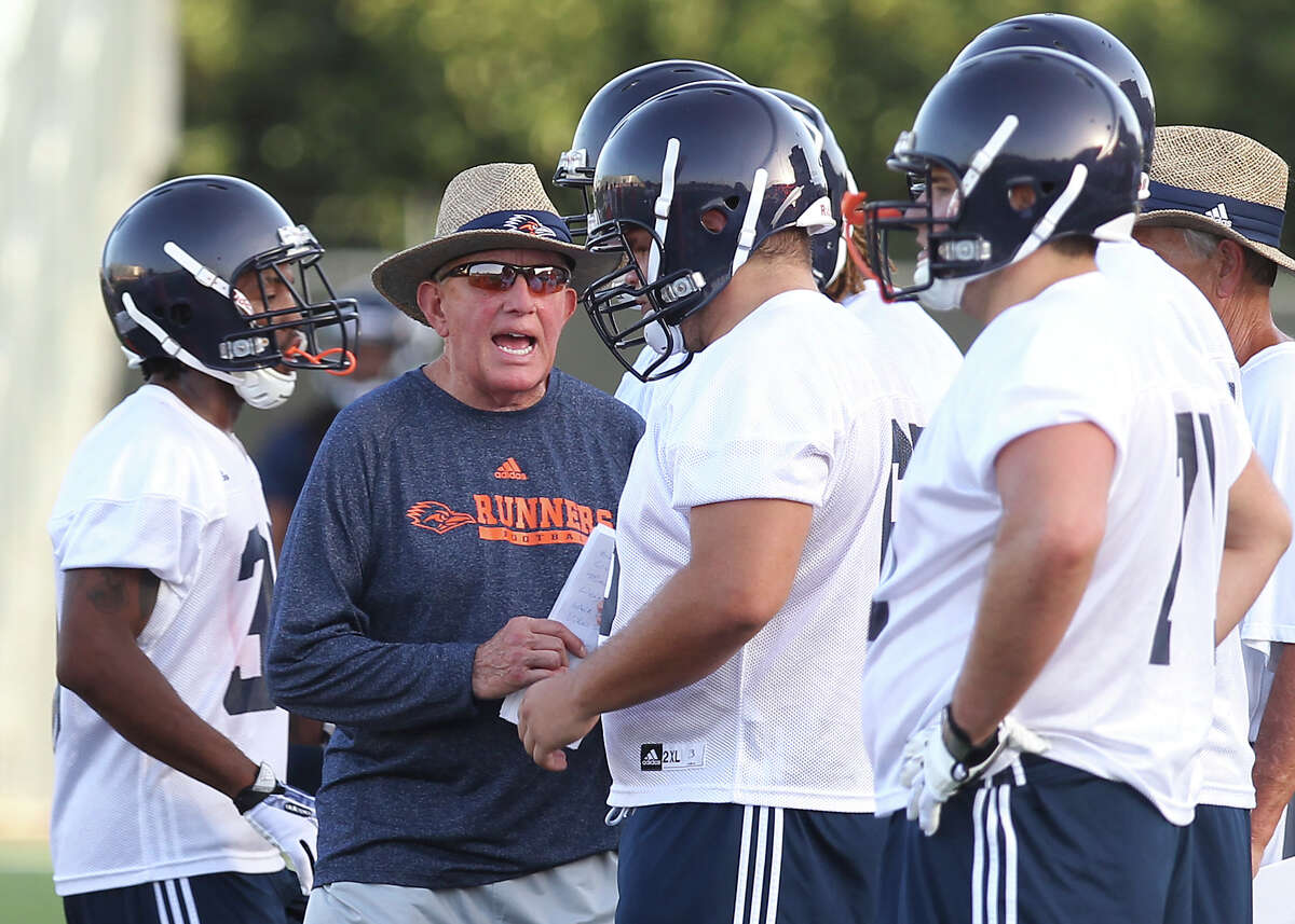 Head coach Larry Coker talks to his offensive line as the UTSA Roadrunners begin their third season of football with fall camp at Farris Stadium on Tuesday, Aug. 6, 2013.