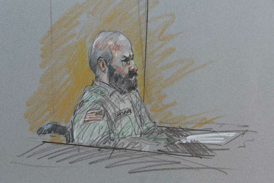 This court room sketch shows Maj. Nidal Malik Hasan during his court-martial Tuesday, Aug. 6, 2013, in Forth Hood, Texas.  Hasan is representing himself against charges of murder and attempted murder for the 2009 attack that left 13 people dead at Forth Hood.  (AP Photo/Brigitte Woosley) ORG XMIT: TXMO114 Photo: Brigitte Woosley / AP