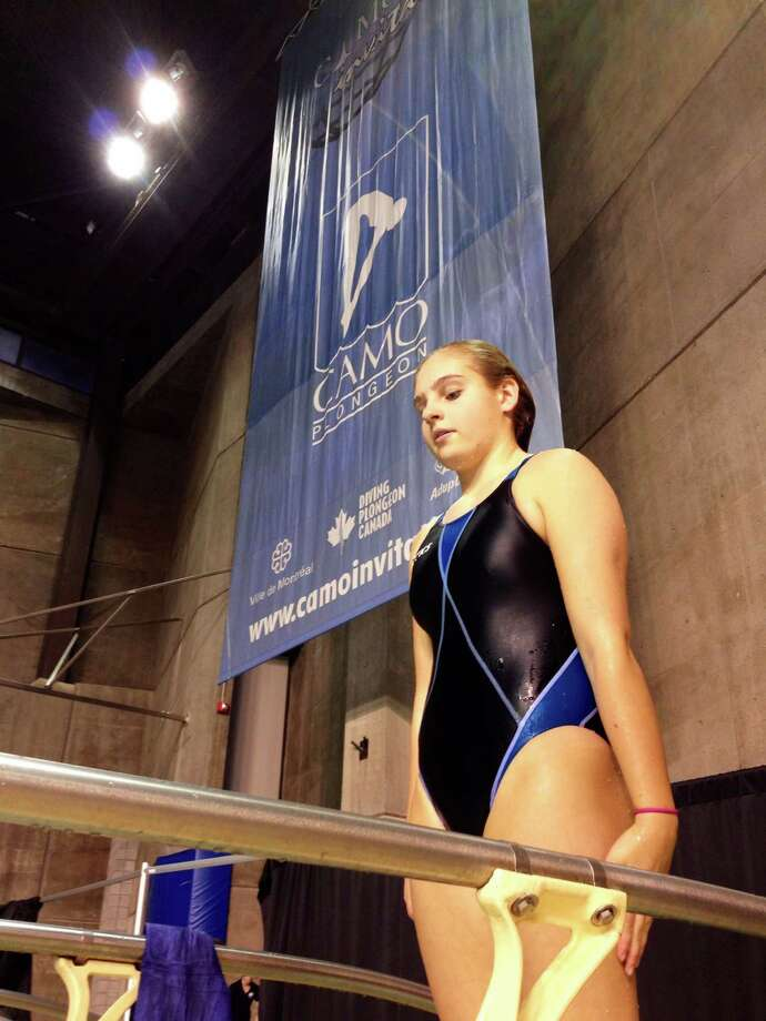 Elizabeth Fitzpatrick of the YMCA Marlins  prepares to dive at the 15th Annual International CAMO invitational, which was held recently at the Claude-Robillard Sports Centre in Montreal, Quebec. Photo: Contributed Photo