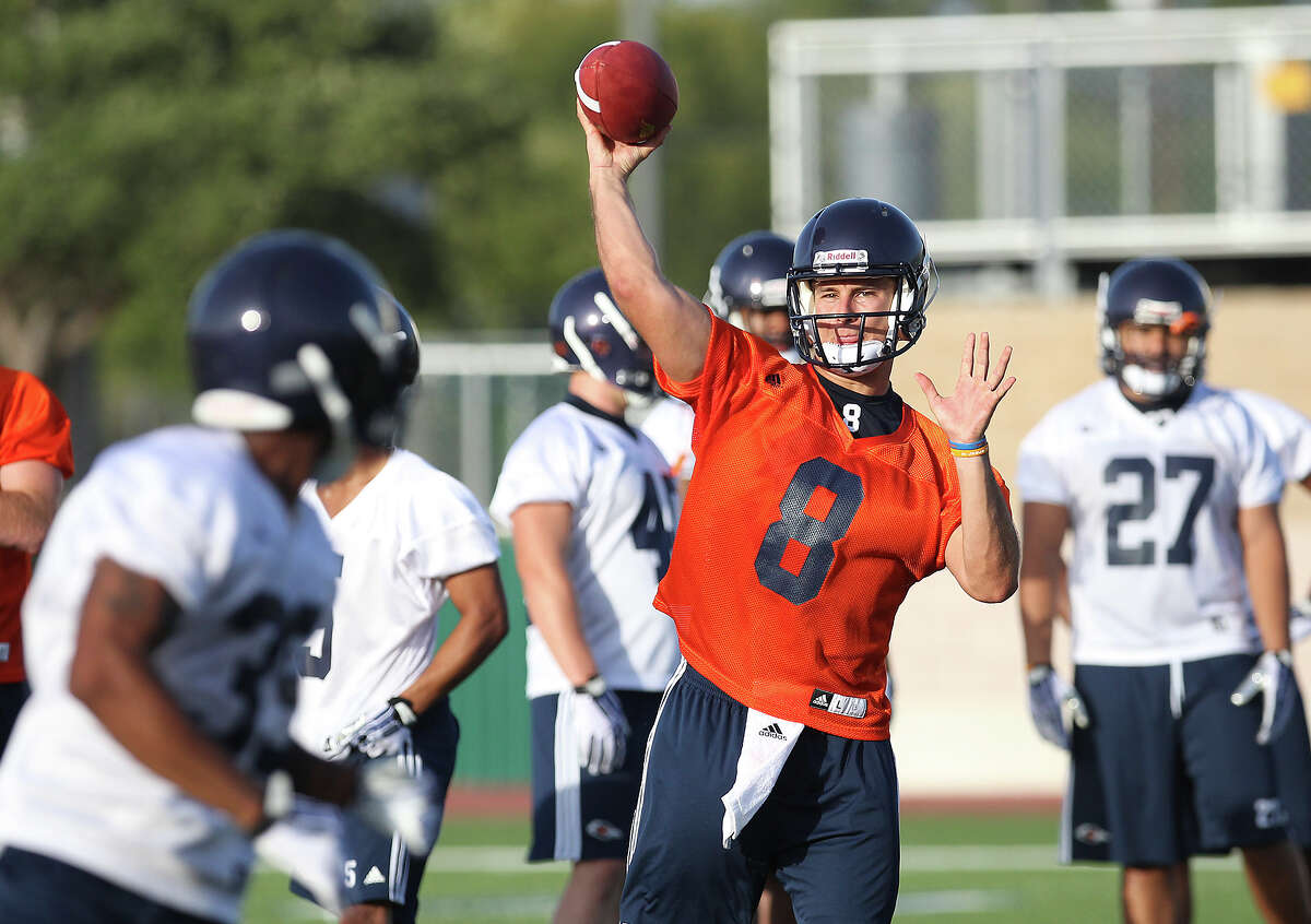 Quarterback Eric Soza (08) throws the ball to a receiver at practice as the UTSA Roadrunners begin their third season of football with fall camp at Farris Stadium on Tuesday, Aug. 6, 2013.