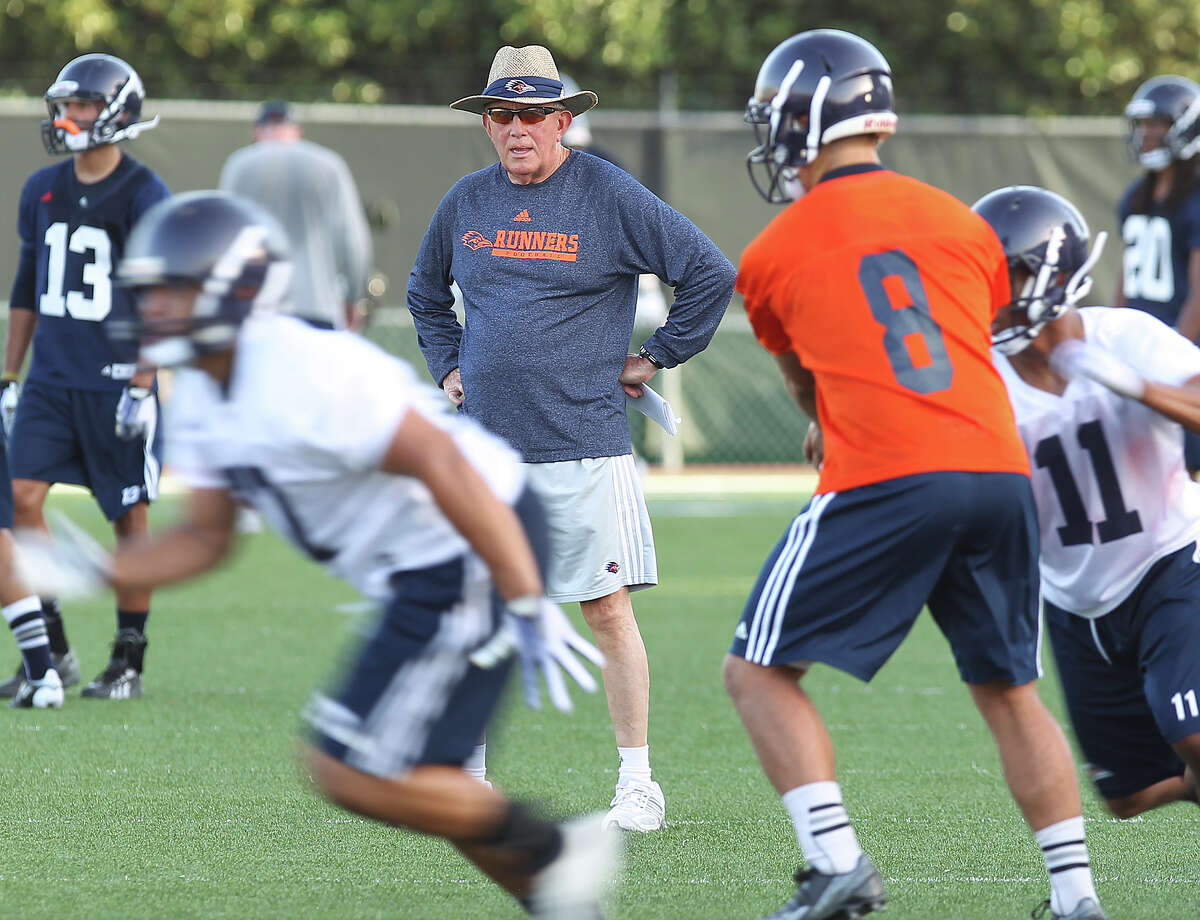 Head coach Larry Coker watches his team at practice as the UTSA Roadrunners begin their third season of football with fall camp at Farris Stadium on Tuesday, Aug. 6, 2013.