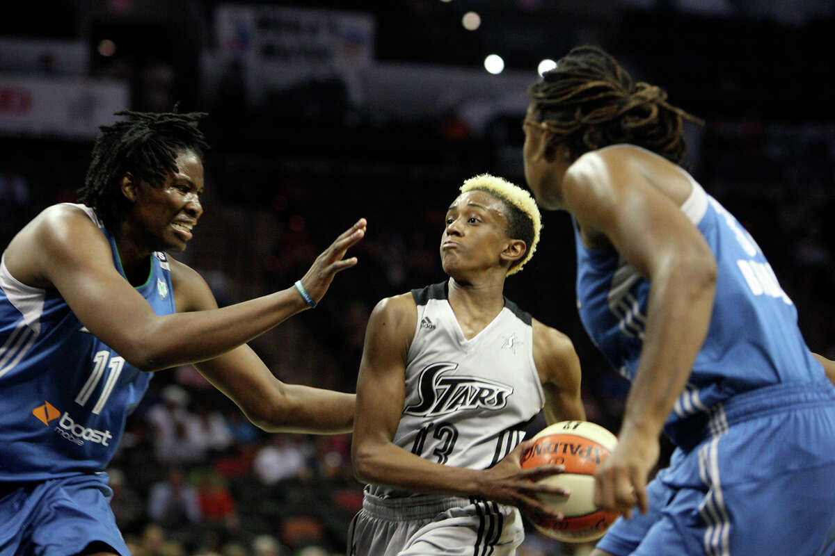 Danielle Robinson (13) goes for a layup at the game between the Silver Stars and the Minnesota Lynx at the AT&T Center on Tuesday, Aug. 6, 2013. The Lynx beat the Silver Stars, 80-93.