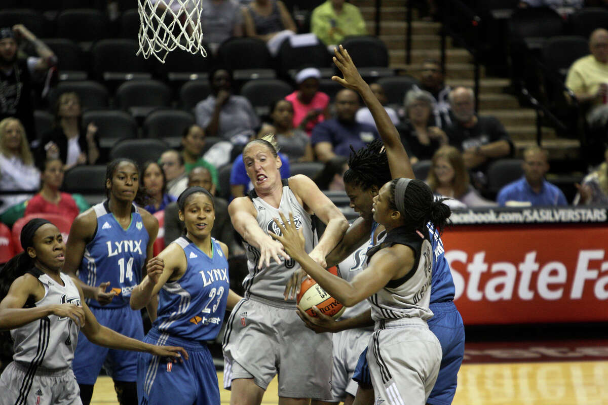 Players scramble for the ball at the game between the Silver Stars and the Minnesota Lynx at the AT&T Center on Tuesday, Aug. 6, 2013. The Lynx beat the Silver Stars, 80-93.