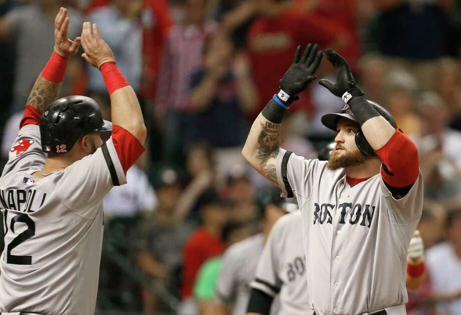 Boston Red Sox's Mike Napoli (12) welcomes Jonny Gomes home after he hit a three-run home run against the Houston Astros in the sixth inning of a baseball game Tuesday, Aug. 6, 2013, in Houston. (AP Photo/Pat Sullivan) ORG XMIT: HTA116 Photo: Pat Sullivan / AP