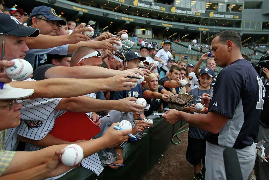 CHICAGO, IL - AUGUST 06: Alex Rodriguez #13 of the New York Yankees signs autographs before a game against the Chicago White Sox at U.S. Cellular Field on August 6, 2013 in Chicago, Illinois. (Photo by Jonathan Daniel/Getty Images) ORG XMIT: 163494883 Photo: Jonathan Daniel / 2013 Getty Images