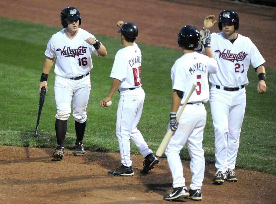 ValleyCats celebrate after scoring on a two run Ronnie Mitchell single during their baseball game against Williamsport at Joe Bruno Stadium on Tuesday Aug. 6, 2013 in Troy, N.Y. (Michael P. Farrell/Times Union) Photo: Michael P. Farrell / 10023386A