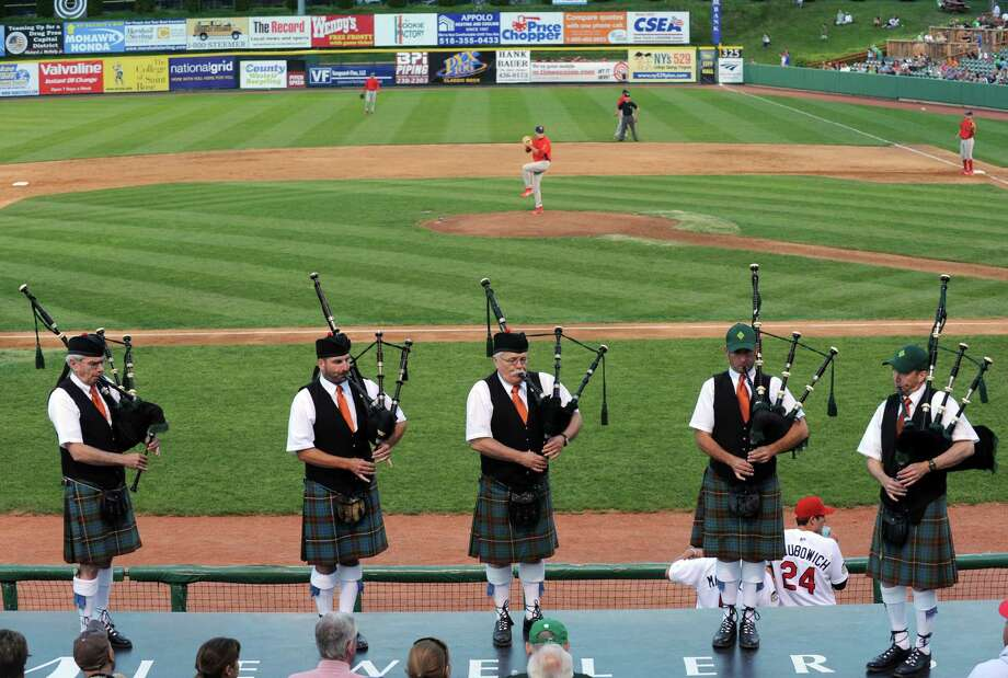 The Columbia District Pipe Band of Hudson performs between innings as part of Irish night at the ValleyCats against Williamsport baseball game at Joe Bruno Stadium on Tuesday Aug. 6, 2013 in Troy, N.Y. (Michael P. Farrell/Times Union) Photo: Michael P. Farrell / 10023386A