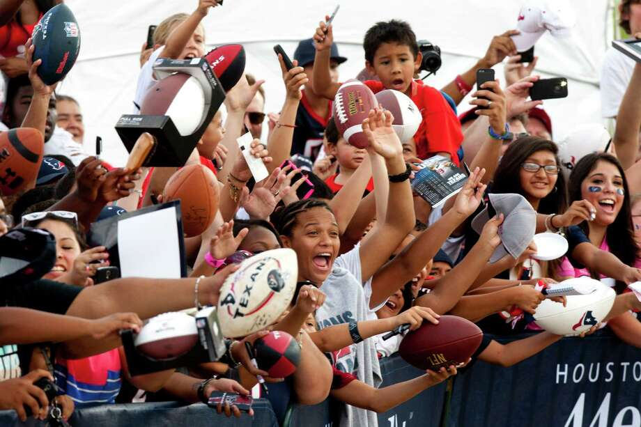 Houston Texans fans seek autographs during Texans training camp at the Methodist Training Center Monday, Aug. 5, 2013, in Houston.  ( Brett Coomer / Houston Chronicle ) Photo: Brett Coomer, Staff / © 2013 Houston Chronicle