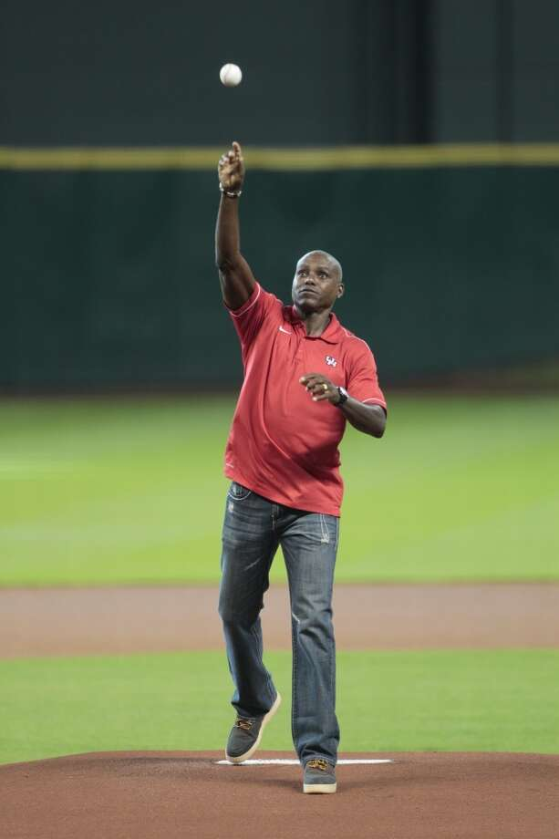 Olympic gold medalist and former UH athlete Carl Lewis throws out the first pitch. Photo: Billy Smith II, Houston Chronicle