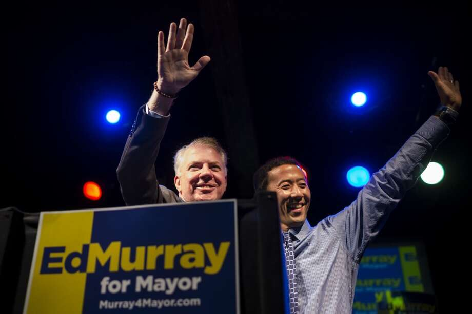 Mayoral candidate Ed Murray, left, and husband Michael Shiosaki, right, take to the podium at Murray's election party on the evening of the Mayoral Primary Election Tuesday, August 6, 2013, at The Crocodile in the Belltown neighborhood of Seattle. Photo: JORDAN STEAD, SEATTLEPI.COM