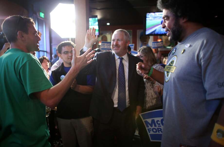 Seattle Mayor Mike McGinn gets a high five from a supporter at 95 Slide in Seattle's Capitol Hill neighborhood on Thursday, August 6, 2013. The first round of election returns had McGinn still in the race with Senator Ed Murray for Seattle Mayor. Photo: JOSHUA TRUJILLO, SEATTLEPI.COM