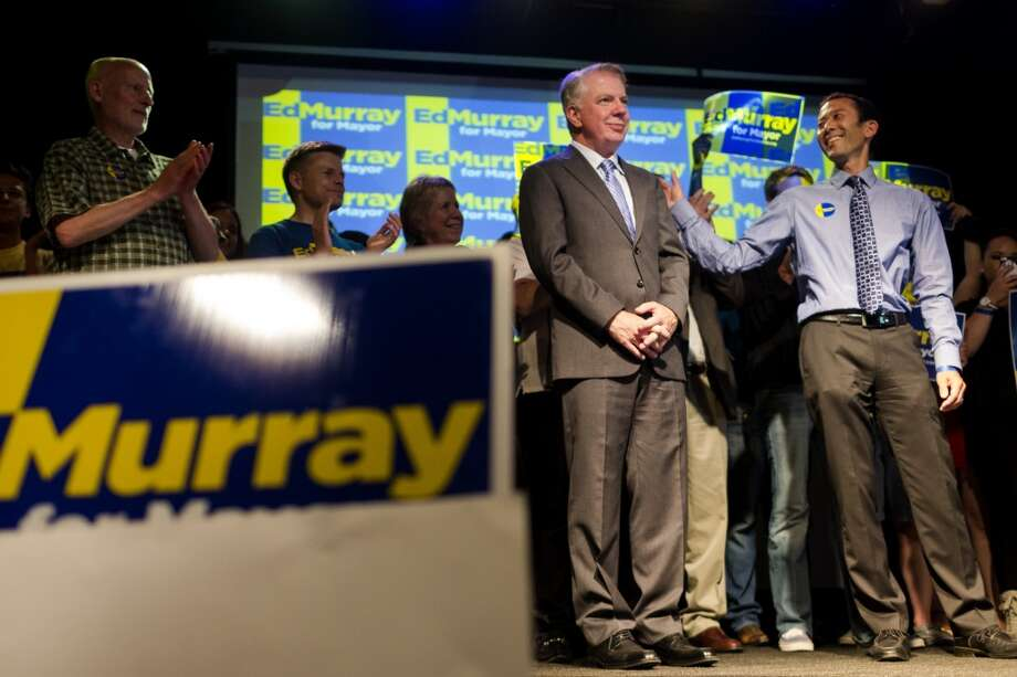 Mayoral candidate Ed Murray, center right, and husband Michael Shiosaki, right, take to the stage at Murray's election party on the evening of the Mayoral Primary Election Tuesday, August 6, 2013, at The Crocodile in the Belltown neighborhood of Seattle. Photo: JORDAN STEAD, SEATTLEPI.COM