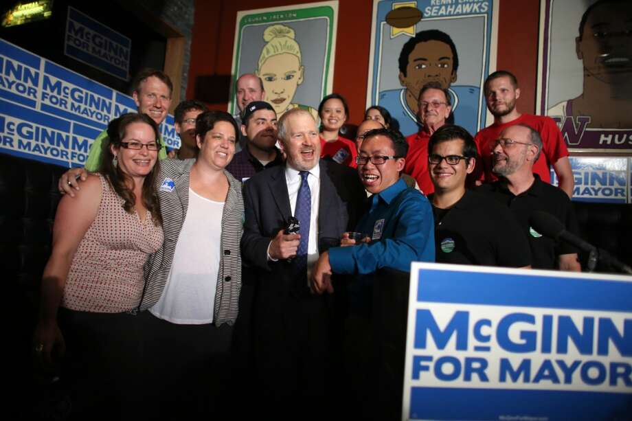 Seattle Mayor Mike McGinn poses with staff after returns came in at 95 Slide in Seattle's Capitol Hill neighborhood on Thursday, August 6, 2013. The first round of election returns had McGinn still in the race with Senator Ed Murray for Seattle Mayor. Photo: JOSHUA TRUJILLO, SEATTLEPI.COM