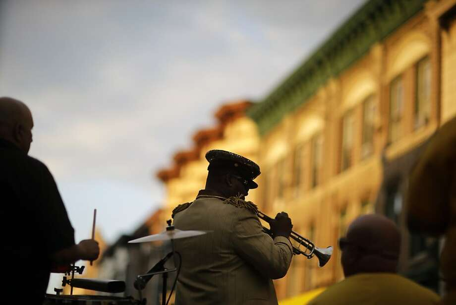 Alberto Plummer plays the trumpet with his band Havana Rumba Tuesday, Aug. 6, 2013, in Union City, N.J., during a National Night Out Against Crime celebration. New Jersey Gov. Chris Christie attended the events. (AP Photo/Mel Evans) Photo: Mel Evans, Associated Press