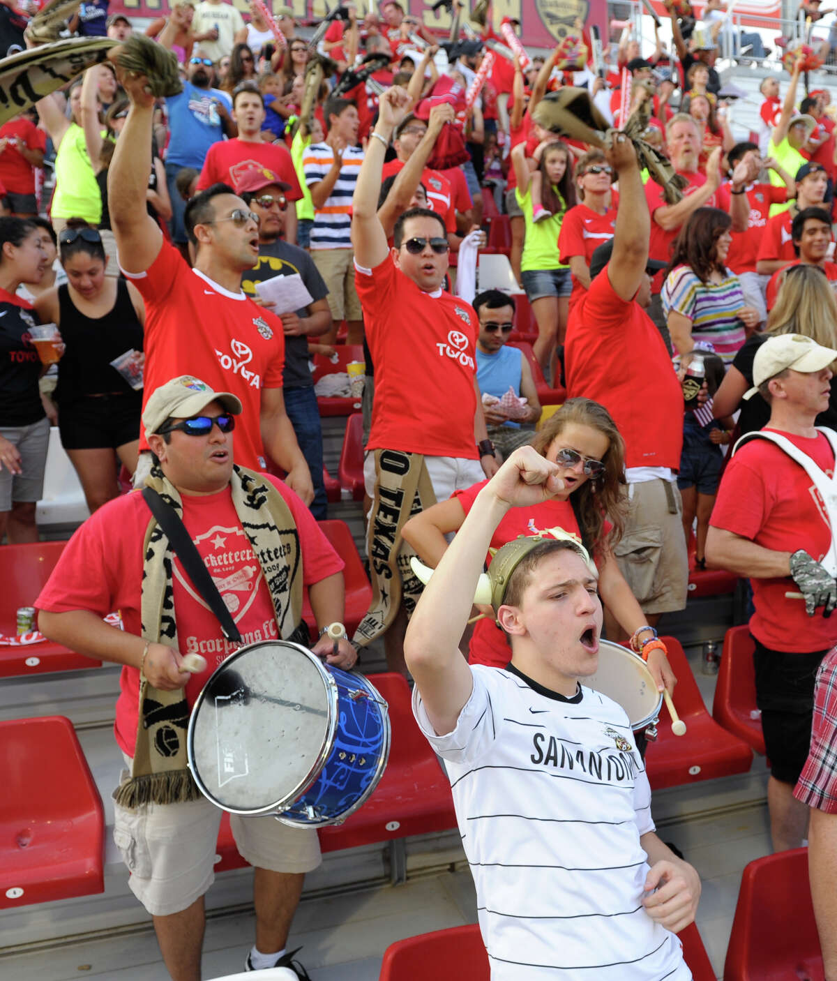 Members of the Crocketeers supporter group cheer on the Scorpions.