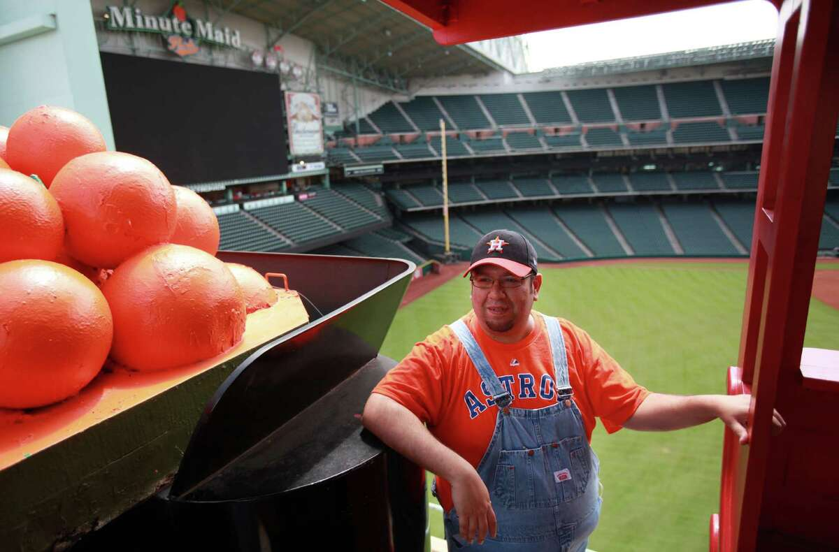 Bobby Dynamite conducts the Astros Train at Minute Maid Park during home games on Thursday, Aug. 1, 2013, in Houston.