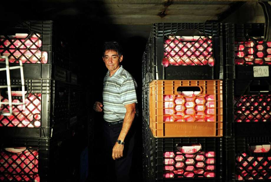 Doug Wade, co-owner of Wade's Dairy, a family-owned and operated business, walks past milk crates in his Bridgeport company. Wade charged that Marcus Dairy was undercutting competitors in the bidding process, then secretly charging districts more during contract periods. After a state investigation, Marcus  has agreed to pay public school systems throughout the state tens of thousands of dollars for overcharges on milk-delivery contracts. Photo: Autumn Driscoll / Connecticut Post