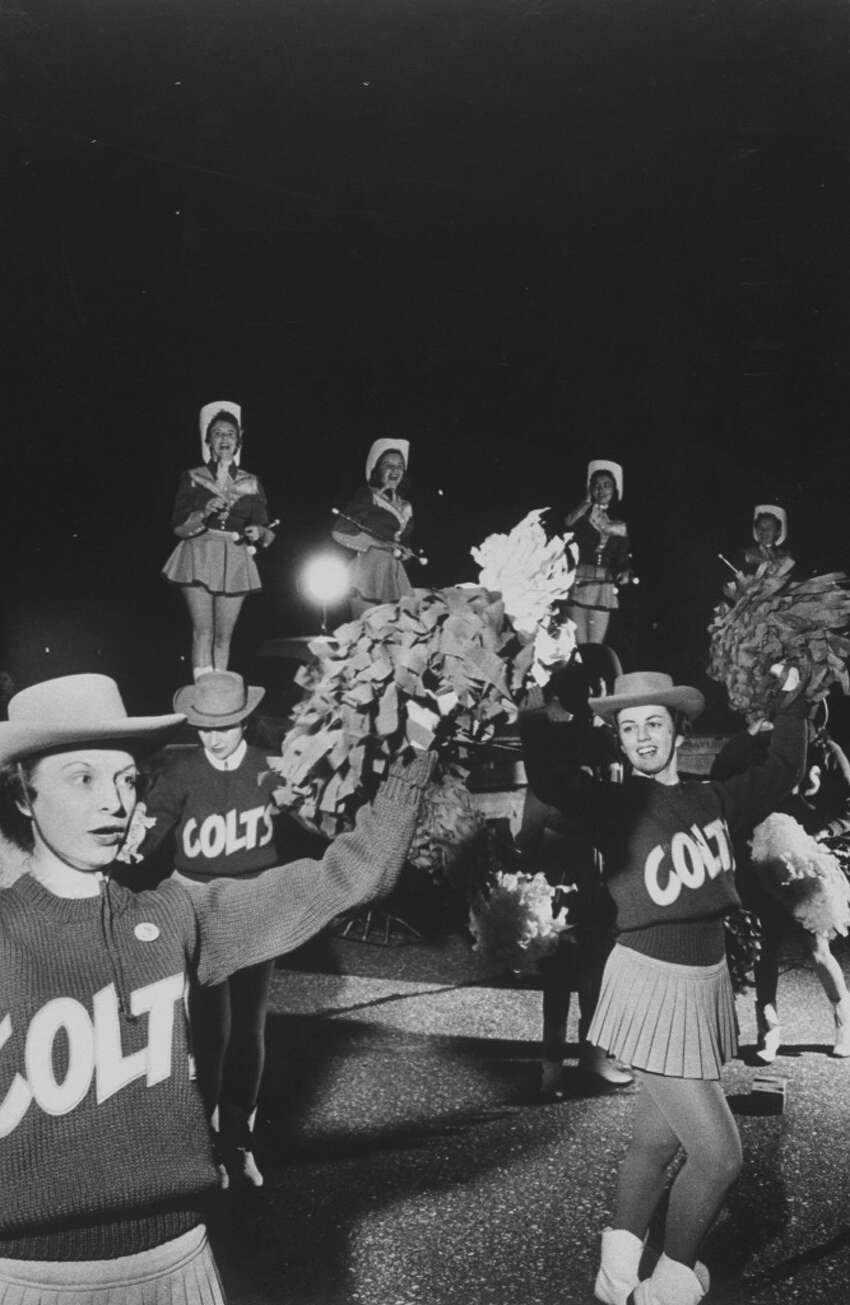 The Baltimore Colts' cheerleaders, both male and female, in the 1950s.