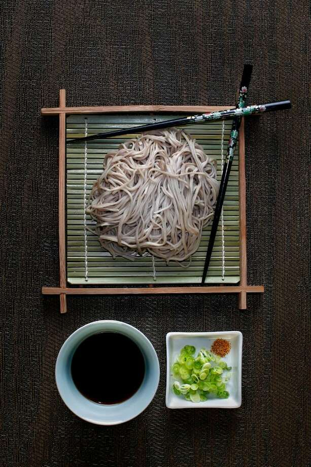 A meal of soba noodles, with tsuyu sauce, chopped green onion and shichimi powder. (Jay L. Clendenin/Los Angeles Times/MCT) Photo: Jay L. Clendenin, MCT / Los Angeles Times