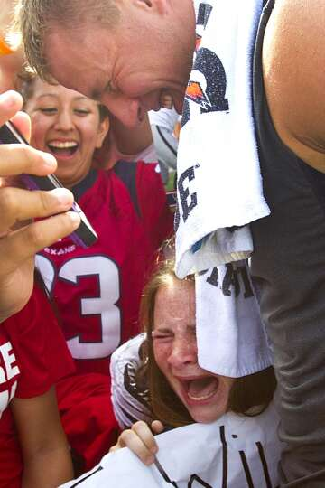 Katie Kaulfold reacts as she is hugged by  J.J. Watt.