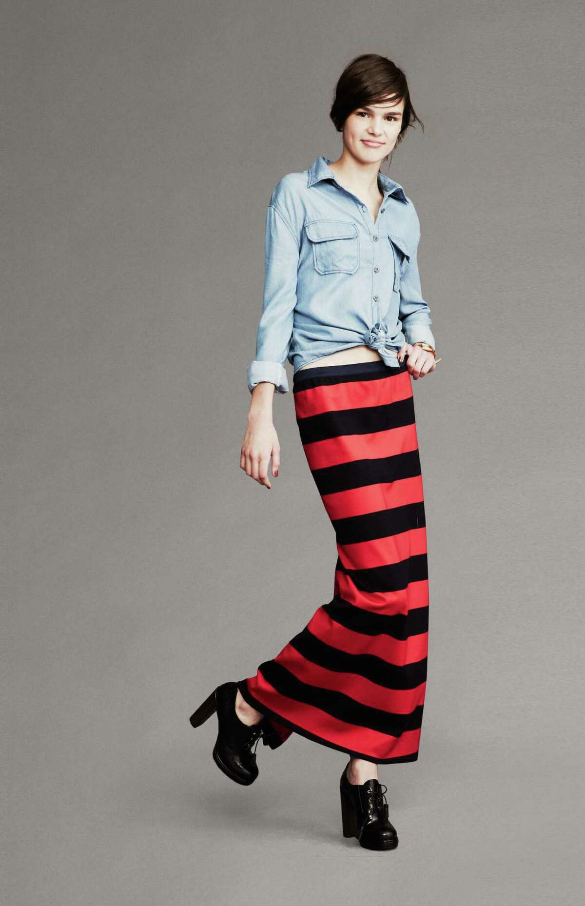 A chambray denim shirt is teamed with an awning-striped maxi skirt.