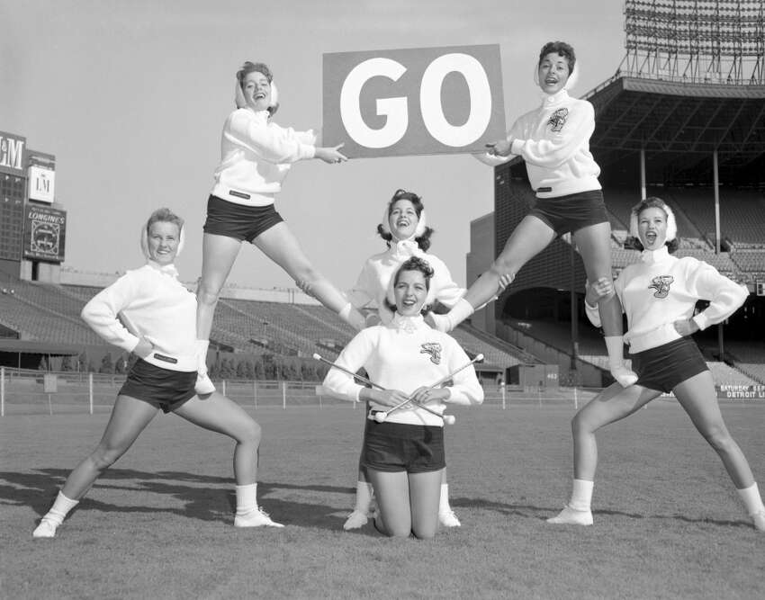 NFL cheerleader outfits have changed a lot over the years. Take a look back at over 50 years of NFL cheerleading squads. Here, members of the Brownettes cheerleading squad pose for a publicity photo in 1958.