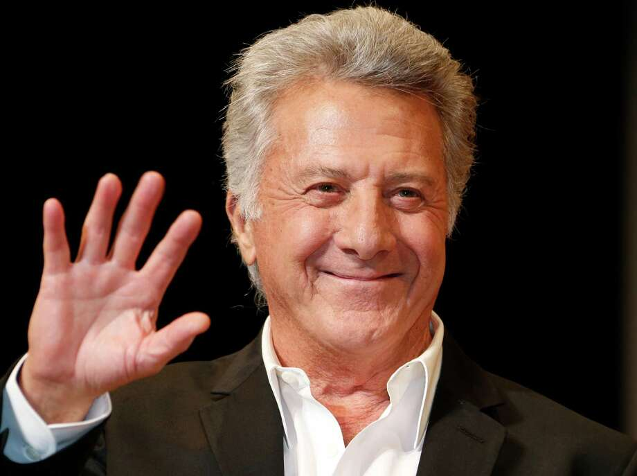 """FILE - In this April 8, 2013 file photo, actor Dustin Hoffman waves to fans during the Japan Premiere of his film, """"Quartet,""""  in Tokyo. A spokeswoman for the 75-year-old actor-director confirmed a People.com report Tuesday, Aug. 6, 2013, that says Hoffman is """"in good health"""" after undergoing surgical treatment for cancer. (AP Photo/Koji Sasahara, File) ORG XMIT: CAPH341 Photo: Koji Sasahara / AP"""