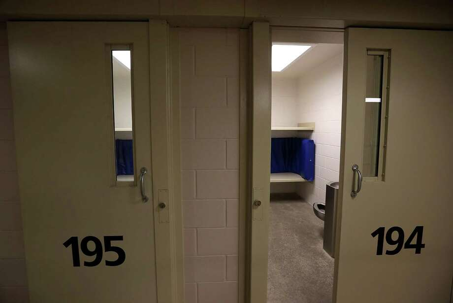 FREMONT, CA - AUGUST 01:  Jail cells sit empty at the Fremont Police Detention Facility on August 1, 2013 in Fremont, California. The Fremont Police Department has started to offer inmates who are serving short sentences on lesser charges an option to ''pay to stay'' for a one-time fee of $45 and $155 a night to stay in a smaller, quieter facility and avoid going to county jails. The city could stand to make $244,000 annually if 16 inmates spent two nights a week under the program. (Photo by Justin Sullivan/Getty Images) ORG XMIT: 175584914 Photo: Justin Sullivan / 2013 Getty Images