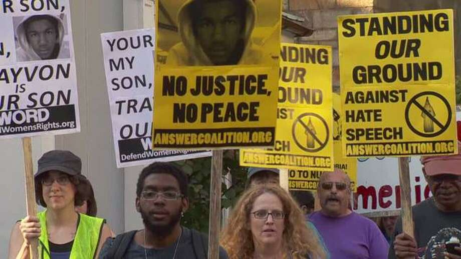 Dozens of people descended on Toad's Place on Tuesday, Aug. 6 to protest the southern rocker's performance in the wake of controversial remarks he made about Trayvon Martin. Photo: WTNH