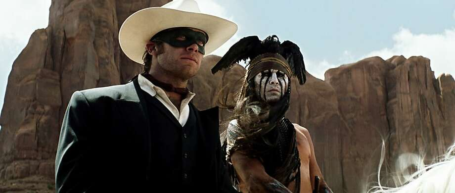 """This undated publicity photo released by Disney and Jerry Bruckheimer, Inc. shows Armie Hammer, left, as The Lone Ranger, and Johnny Depp, as Tonto, in a scene from the film, """"The Lone Ranger."""" The movie releases July 3, 2013. (AP Photo/Disney/Jerry Bruckheimer, Inc., Peter Mountain, File) Photo: Peter Mountain, Associated Press"""