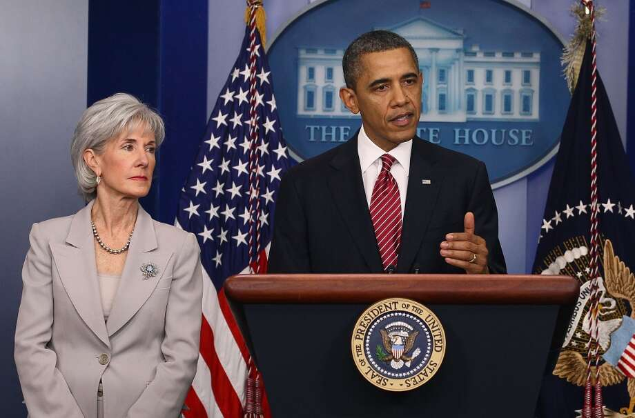 President Barack Obama and Health and Human Services Secretary Kathleen Sebelius announce in February 2012 a reversal of his health care rule requiring religious employers to provide women free access to contraception. The Supreme Court could take up the issue this session. Photo: Getty Images