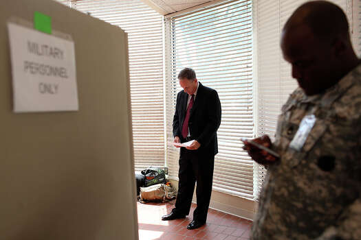 Tom Rheinlander, Fort Hood Director of Public Affairs, goes over his notes before making a statement to the media after the trial for Maj. Nidal Hasan was abruptly recessed at Fort Hood in Killeen on Wednesday, August 7, 2013. Photo: Lisa Krantz, San Antonio Express-News / San Antonio Express-News