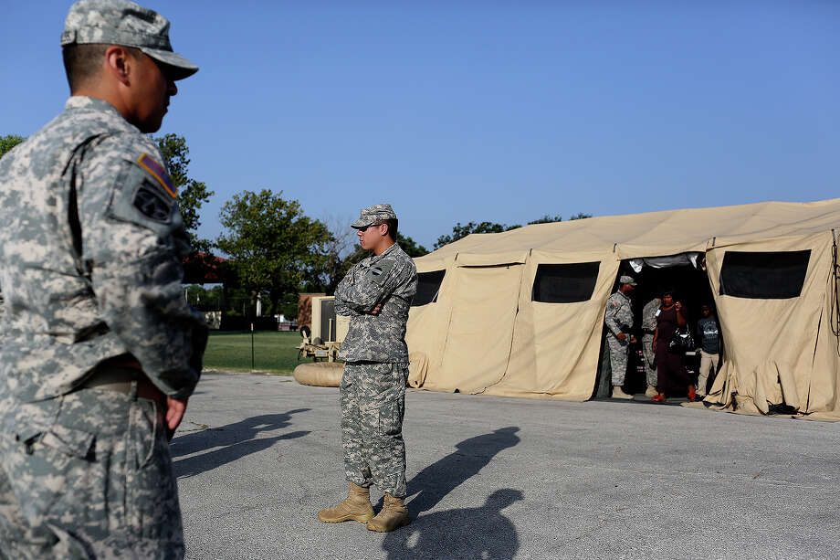 Soldiers stand guard at a security checkpoint outside the Lawrence H. Williams Judicial Center on the second day of the trial for Maj. Nidal Hasan at Fort Hood in Killeen on Wednesday, August 7, 2013. Photo: Lisa Krantz, San Antonio Express-News / San Antonio Express-News