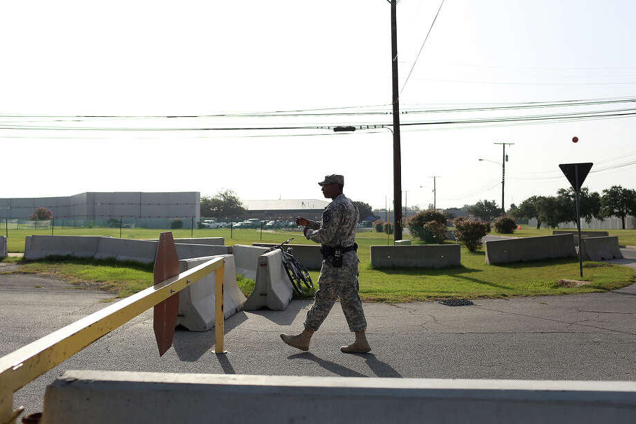 A soldier walks to check in a vehicle at a security checkpoint outside the Lawrence H. Williams Judicial Center on the second day of the trial for Maj. Nidal Hasan at Fort Hood in Killeen on Wednesday, August 7, 2013. Photo: Lisa Krantz, San Antonio Express-News / San Antonio Express-News