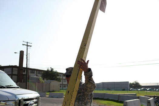 A soldier holds up a gate to allow a vehicle into a security checkpoint outside the Lawrence H. Williams Judicial Center on the second day of the trial for Maj. Nidal Hasan at Fort Hood in Killeen on Wednesday, August 7, 2013. Photo: Lisa Krantz, San Antonio Express-News / San Antonio Express-News
