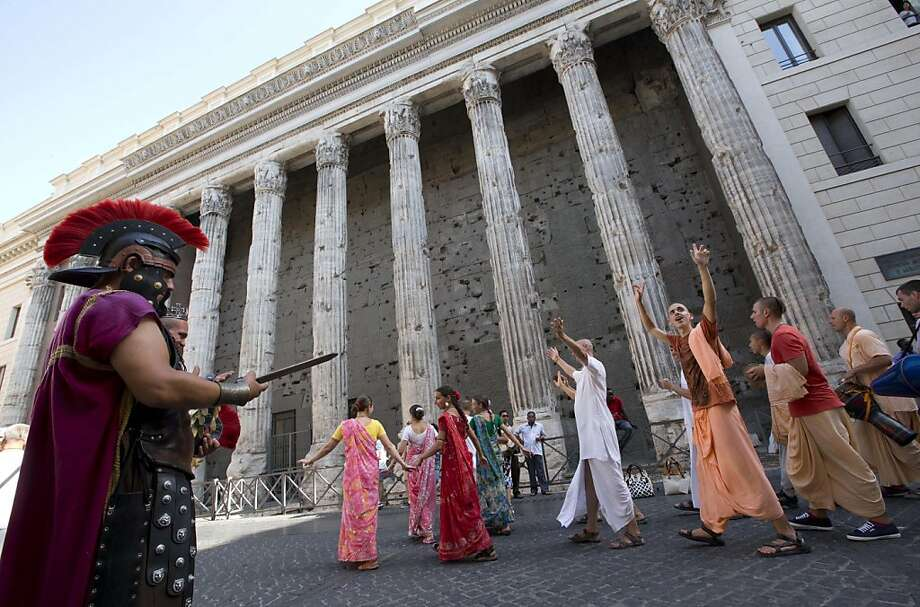 Suddenly the centurion felt compelled to draw his sword:Hare Krishna devotees chant and dance in downtown Rome. Photo: Andrew Medichini, Associated Press